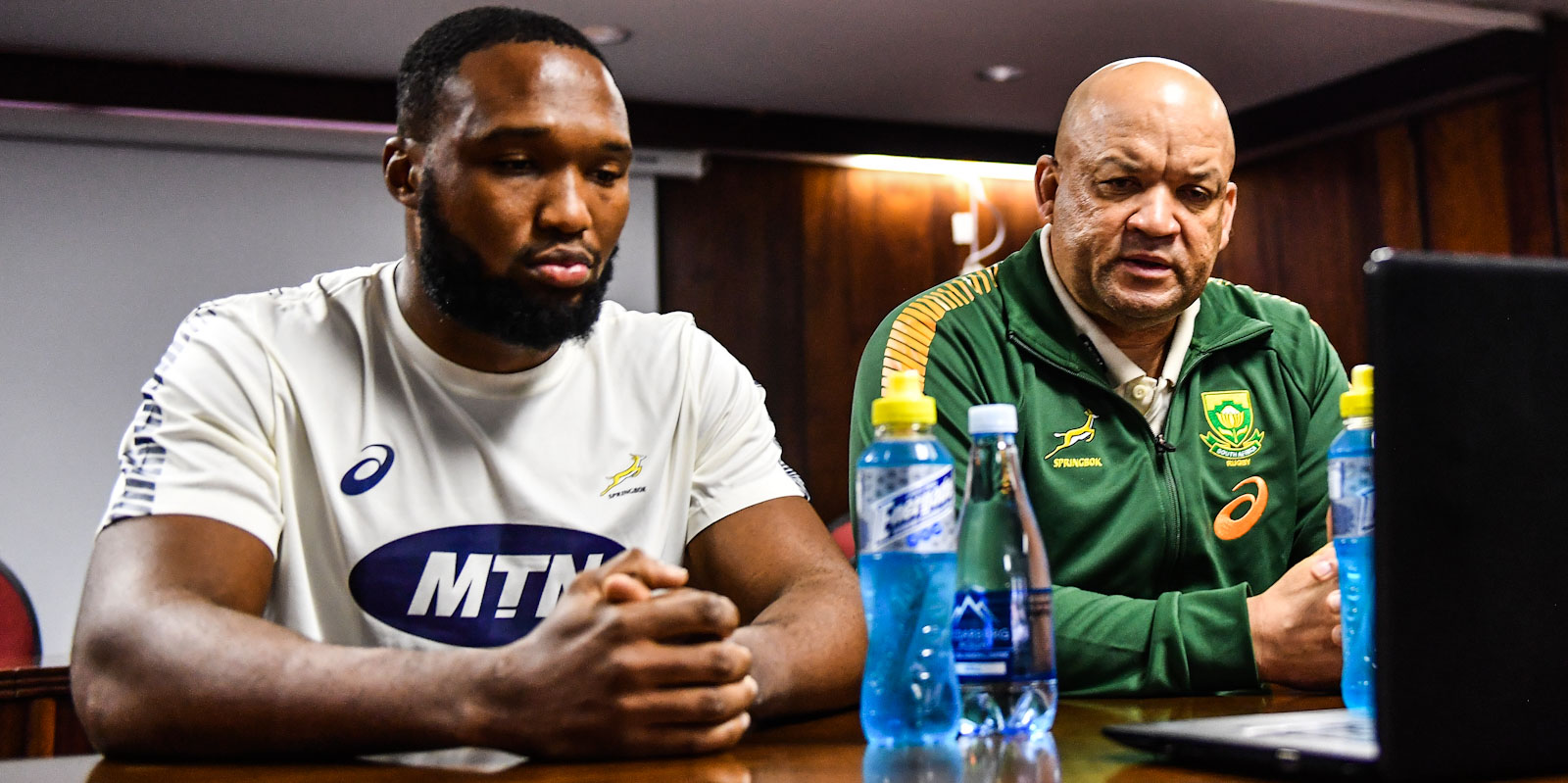 "Gold captain and coach, Lukhanyo Am (left) and Deon Davids, ""face"" the media."