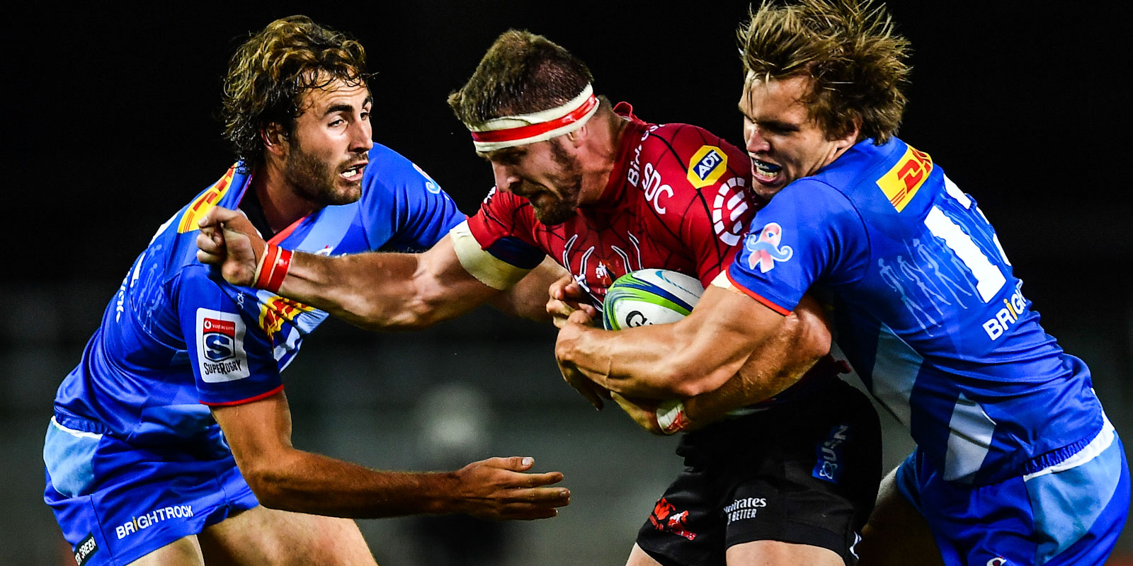 DHL Stormers midfielders Rikus Pretorius (left) and Dan du Plessis attempt to tackle Jaco Kriel of the Emirates Lions.