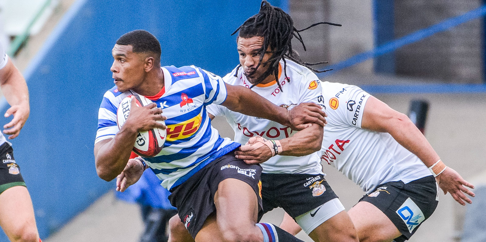 The Toyota Cheetahs' Rosco Specman stops Damian Willemse of DHL WP