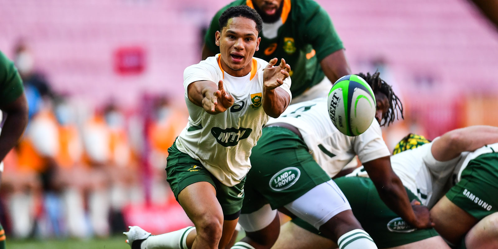 Herschel Jantjies gets the ball away for the Gold team.