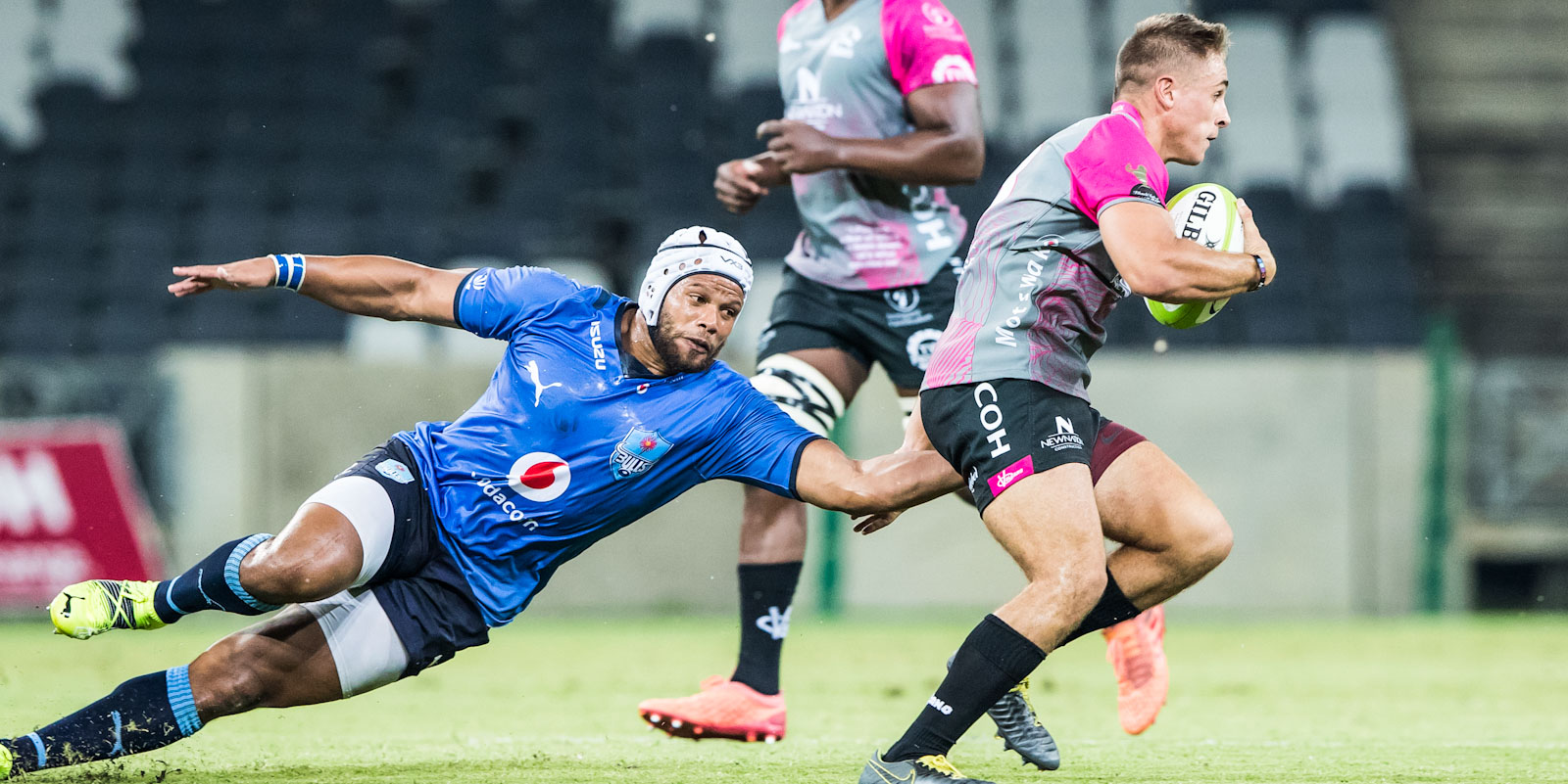 Vodacom Bulls captain Nizaam Carr tries to stop Sebastiaan de Klerk of the New Nation Pumas.